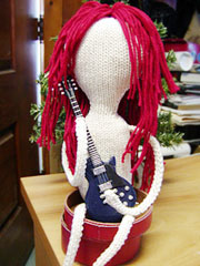 knitted doll with guitar