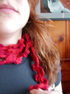 http://midnightknitter.com/blog/wp-content/uploads/2006/12/ultramerino4-red-curl1.jpg