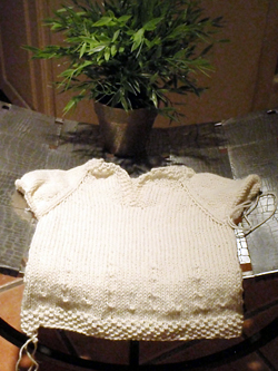 http://midnightknitter.com/blog/wp-content/uploads/baby-sweater.jpg